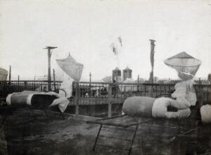 view Israel (?): mosquito nets and folded mattresses on camp beds: the rooftop of a military hospital. Photograph, 1914/1940 (?).