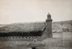 view Jaffa, Palestine: a second world war British army camp kitchen with a turret, rows of small window openings and a grass roof. Photograph by Lieutenant-Colonel (Terence ?) Otway, 1939/1945 (?).