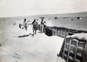 view Sinai Desert, Egypt: first world war front line trenches with three (British) soldiers. Photograph, 1914/1918.