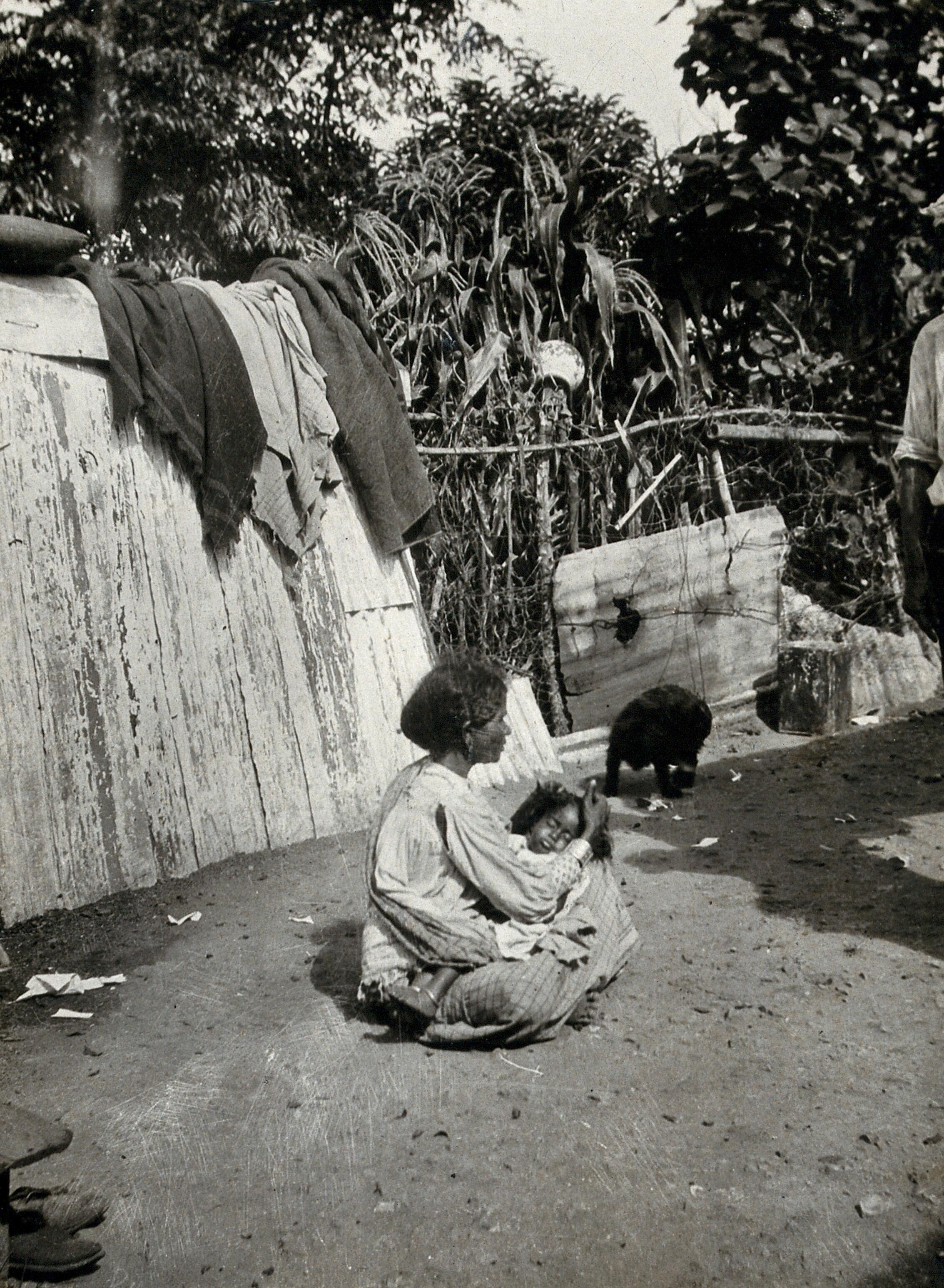 Durban, Natal, South Africa: an Indian mother de-louses the