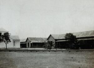 view The Leper Settlement, Providencia Island, Venezuela: the wards (right) and the chapel (left). Photograph, 1890/1910.
