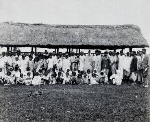 view Charingia, Assam, India: kala-azar patients; a group of men, women and children. Photograph, 1900/1920 (?).
