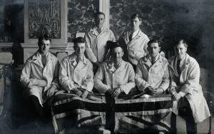view First World War wounded soldiers holding the Union Jack flag: group portrait. Photograph, 1914/1918.