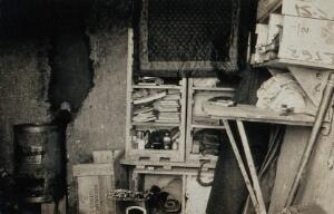 view World War One: a dug-out interior showing shelving and stove. Photograph, 1914/1918.