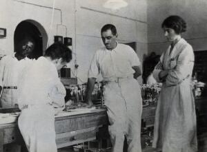 view Medical Research Institute, Accra: medical researchers working on yellow fever. Photograph, 1928.