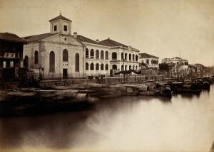 view Canton, China: a missionary church and missionaries' houses. Photograph, 18--.
