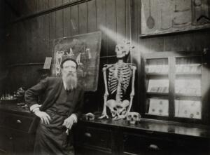 view Cooke's School of Anatomy (London School of Anatomy), London: interior, showing a man with a skeleton. Photograph, ca. 192-.