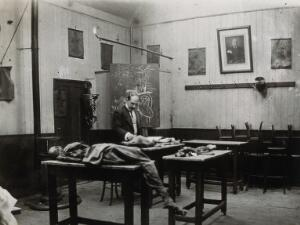 view Cooke's School of Anatomy (London School of Anatomy), London: interior, showing Edward Knight with anatomical specimens. Photograph, ca. 192-.
