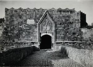 view Rhodes: a gateway in the old walls of the city. Photograph, 1931.