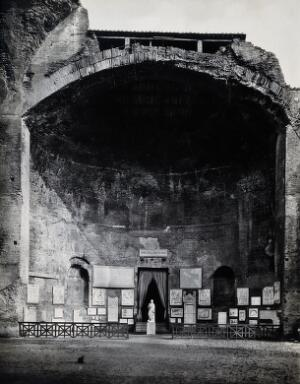 view Rome: remains of a room at the baths of Diocletian, including antique sculpture and plaques. Photograph by Anderson, ca. 1931.