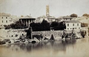 view Rome: view across the River Tiber, showing the Temple of Vesta and the campanile of S. Maria in Cosmedin. Photograph, 1880/1910?