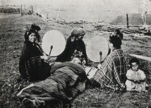 view Costa Rica (?): Mapache medicine women with drums, treating a patient. Photograph of a process print, ca. 1900.