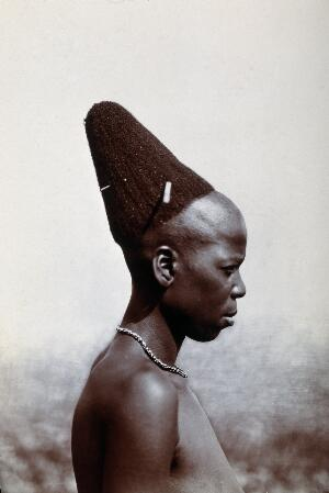 view Zululand: a married Zulu woman with a pyramidal hairdressing. Photograph.