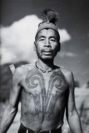 view Assam: a Chang Naga man with a head-hunter's tattoo. Photograph by Christoph von Fürer-Haimendorf.