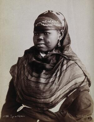 view A North African woman with scarification on her cheeks. Photograph by G. Lekegian, ca. 1900.