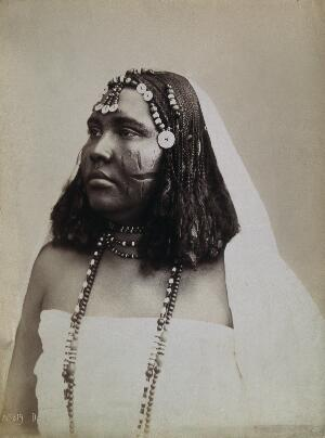 view A North African woman with scarification on her cheeks. Photograph attributed to G. Lekegian, ca. 1900.