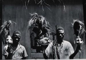 view Benin (Dahomey): men holding staffs made of human skulls with plumes of horsehair. Photograph by Kurt Lubinski (?), 19--.