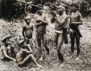 view Borneo: a Dyak man demonstrating the blowpipe. Photograph, 19--.