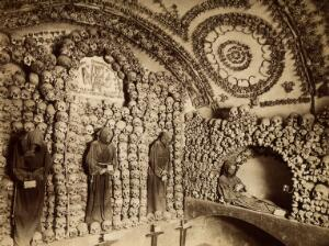 view Santa Maria della Concezione, Rome: skulls and skeletons of the friars arranged in arches and columns around the walls of the Convento dei Cappuccini. Photograph.