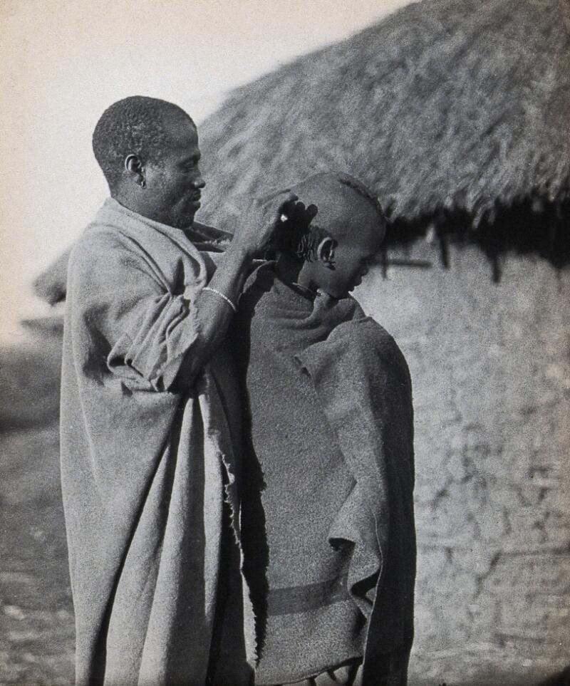 South Africa: a Pondo tribesman attends to the hairstyle ...