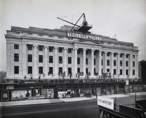 view The Wellcome Research Institution building, Euston Road, London: frontage during final stages of construction by Trollope & Colls, 1931. Photograph.