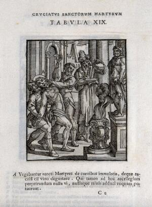 view A Christian man is tortured because he refuses to eat meat or drink wine that have been dedicated in a sacrifice to pagan deities. Woodcut.