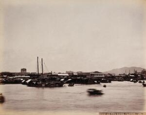 view Canton, China: Canton City from the river with boats and junks in the foreground. Photograph by W.P. Floyd, ca. 1873.