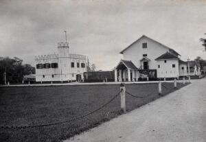 view Kuching, Sarawak: a square-towered building and the jail. Photograph.