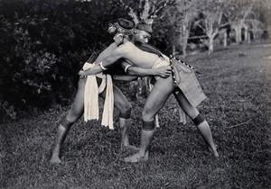 view Sarawak: two native Kayans wrestling. Photograph.