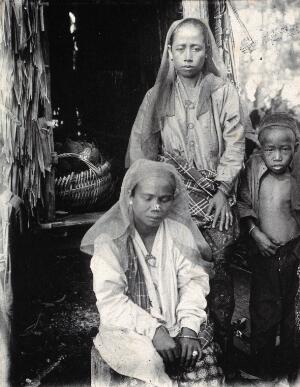 view Sarawak: two Malay women and a child. Photograph.