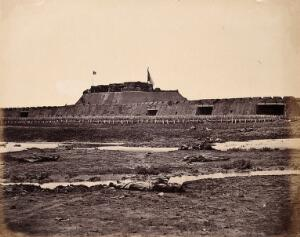view Taku, China: the North Fort bearing raised British and French flags; Chinese corpses in the foreground; on the day of the fort's capture by the English and French armies during the Second China War. Photograph by Felice Beato, 1860.