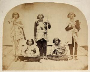 view Nepal: tribespeople bearing sticks: group portrait. Photograph by Clarence Comyn Taylor, ca. 1860.