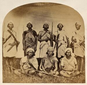 view Nepal: Magar military men bearing weapons: group portrait. Photograph by Clarence Comyn Taylor, ca. 1860.