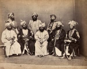 view Pathan men from Peshawar, Pakistan in traditional dress: group portrait. Photograph, ca. 1900.