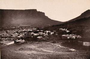 view Cape Town, South Africa: part of the city with Table Mountain and Lion's Head. Woodburytype, 1888, after a photograph by Robert Harris.