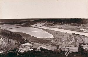 view Port Alfred, South Africa: a port near the mouth of the Kowie River. Woodburytype, 1888, after a photograph by Robert Harris.