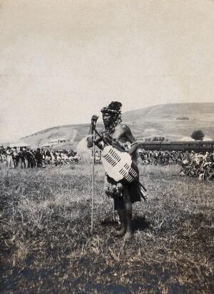 view Natal, South Africa: an African man acting as the official witness at a Zulu wedding at Henley. Photograph by Agnes Henderson, Mrs G.G. Henderson, 1905.