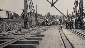 view Zimbabwe: people and a flag-covered train at the opening of Victoria Bridge. Photograph by J. Lomas, 1905.