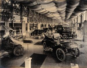 view The 1904 World's Fair, St. Louis, Missouri: an automobile exhibit displaying Packard motorcars. Photograph, 1904.