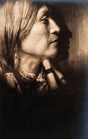 view A Jicarilla Indian Chief, in ceremonial dress, North America. Photograph by Edward S. Curtis, 1904.