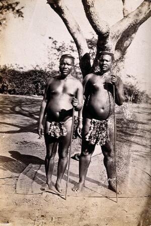view South Africa: two Zulu chiefs: Shingana (half brother of Cetshwayo, the Zulu King) and Ndabuko, Maduna (brother of Cetshwayo). Albumen print.