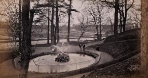 view Fairmount Park, Philadelphia, Pennsylvania: park visitors next to a small lake with a fountain. Photograph by Francis Frith, ca. 1880.