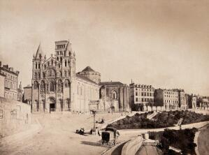 view Angoulême Cathedral, France; showing situation on a road adjacent to other town buildings. Photograph (by Édouard Baldus ?), ca. 1860.