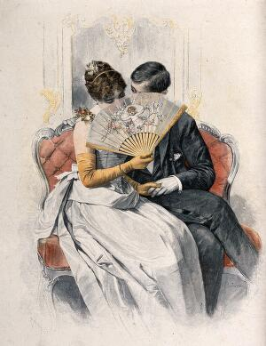 view A young loving couple sit on a sofa holding hands while she coyly holds a fan up to her face. Coloured wood engraving after Rud. Rössler.