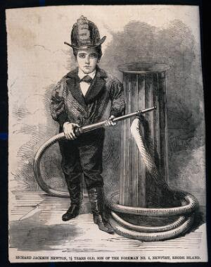 view A small boy stands by a fire hydrant with a fireman's helmet on and a fire hose in his hand. Wood engraving.