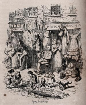 view A street scene with items for sale hanging outside shop fronts, women and children playing and men sitting and standing around smoking pipes. Process print after George Cruikshank.