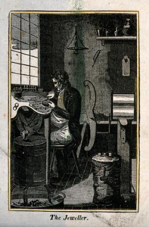 view A man is sitting at a work bench making jewellery. Wood engraving.