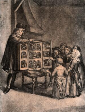 view A man has an open box with figures in it resting on a chair, young children are crowding round to see the show. Mezzotint after E. van Heemskerck..