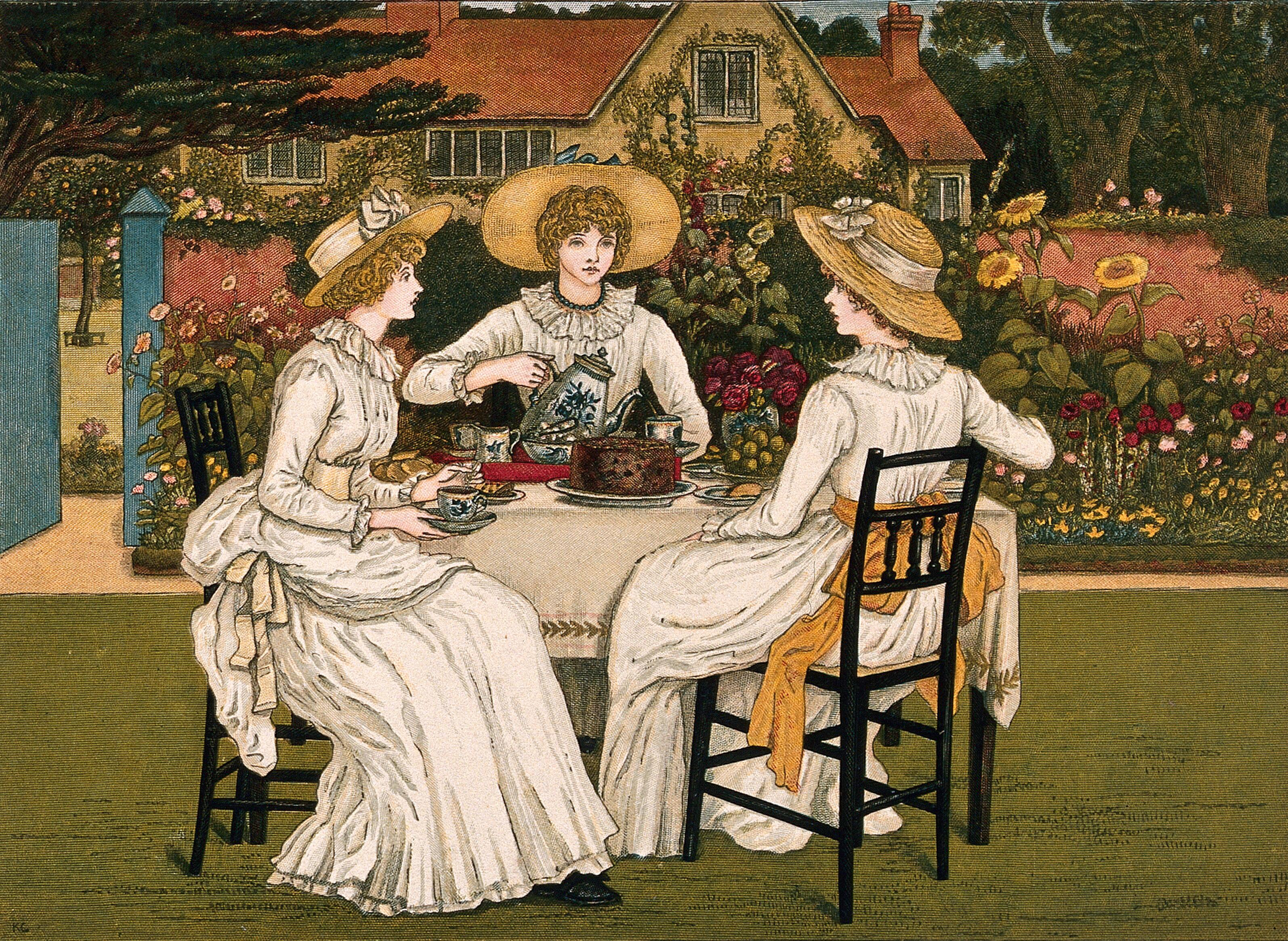 Three young woman are sitting at table in a garden having ...