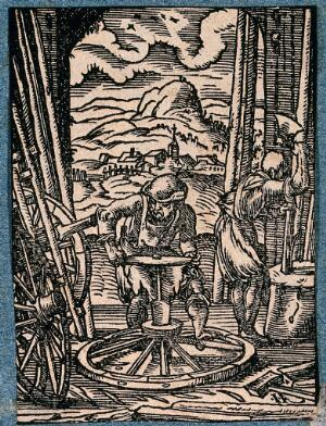 view A wheelright is working in his workshop. Woodcut.